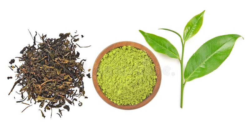 Top view of powder green tea and green tea leaf isolated on whit. E background royalty free stock image