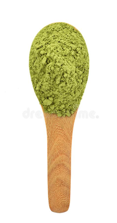 Top view of powder green tea on wooden spoon isolated on white background royalty free stock image