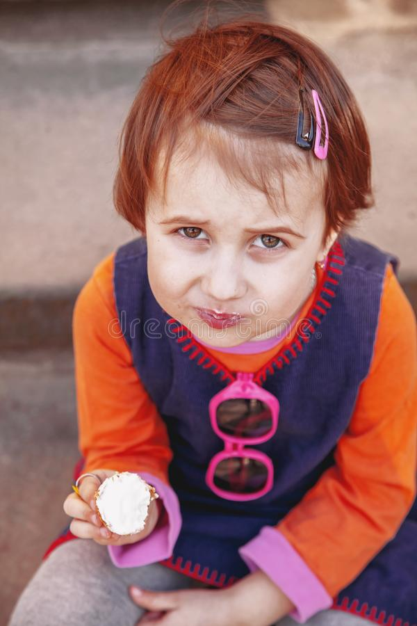 Top view of pretty little child girl eating ice cream outdoors food, dessert, childhood, satisfaction, carelessness concept royalty free stock photos