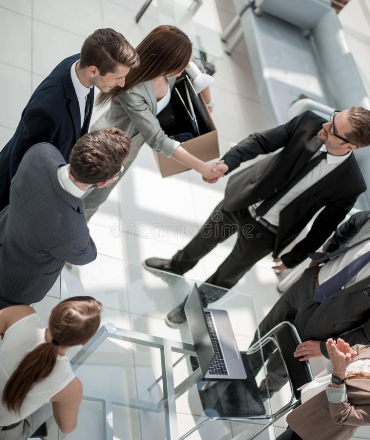 Top view.project Manager shaking hands with new employee stock image