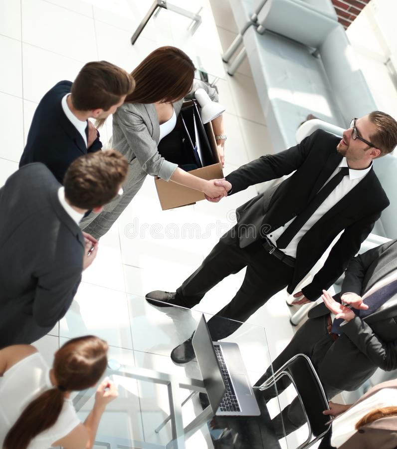 Top view.project Manager shaking hands with new employee royalty free stock image