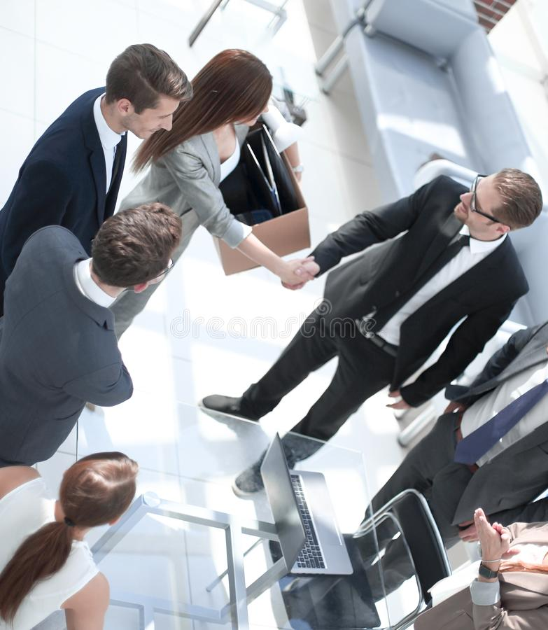 Top view.project Manager shaking hands with new employee royalty free stock photo