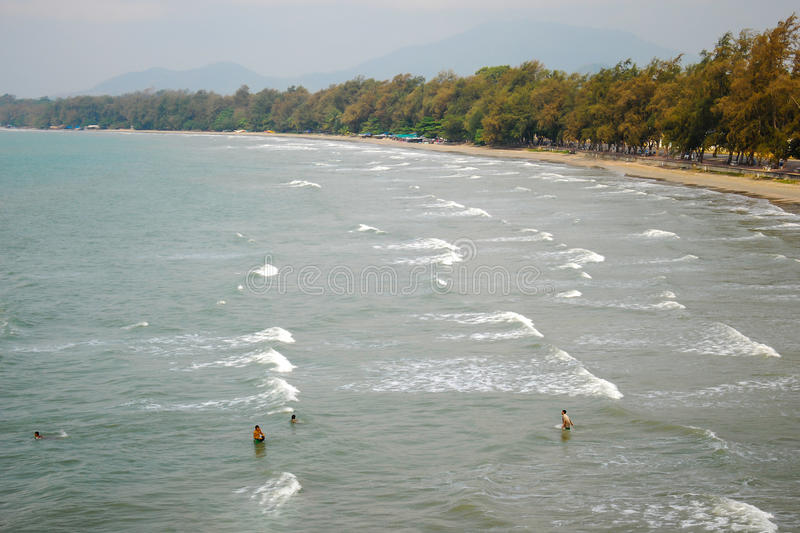 Top view of public beach.Small figures of people in the sea by s stock photography