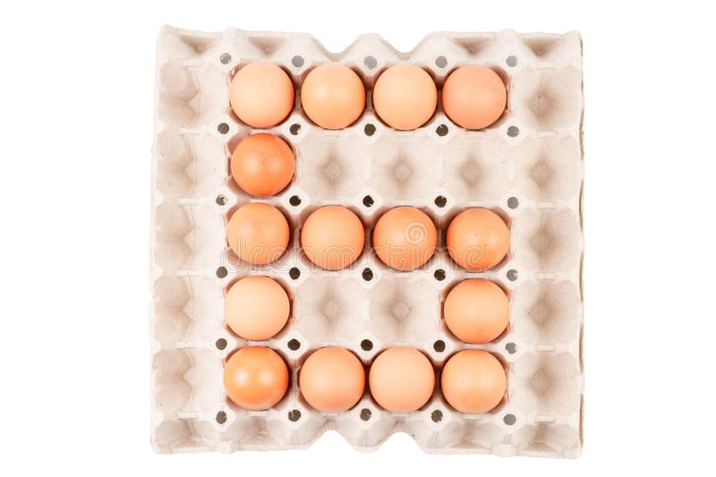 Chicken Eggs In paper container tray box arranged look like Number is ` 6 `. royalty free stock images
