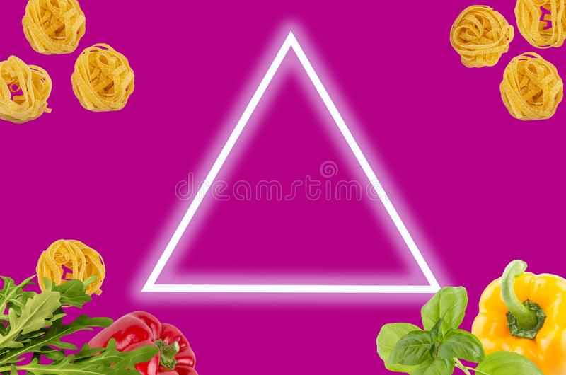 Top view of raw ingredients of taliatele pasta on creative magenta background. Italian tagliatele pasta with peppers, rocket leaves, basil on magenta royalty free stock photos