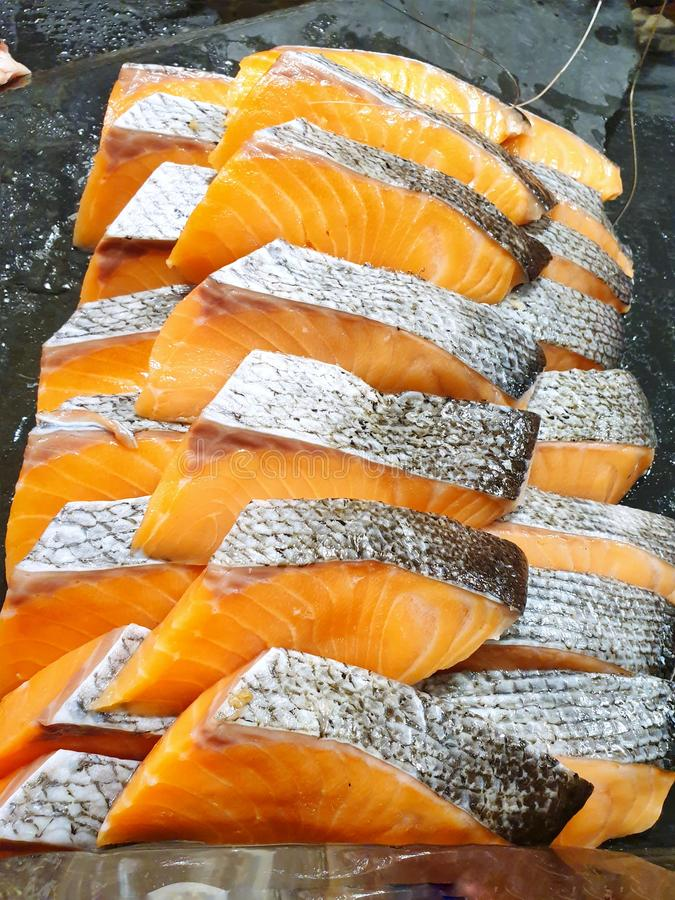 Top view of raw salmon fillets sliced in restaurant. Fresh meat for grill or cooking, Vertical stock images