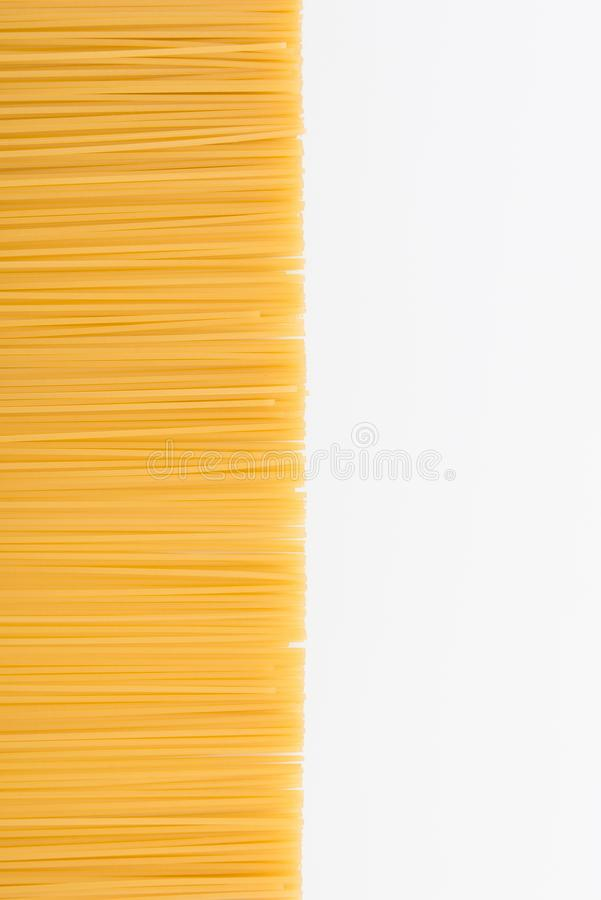Top view of raw vermicelli for making pasta. Isolated on white royalty free stock image