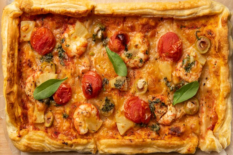 Top view of rectangular pizza with tomatoes and shrimps stock photo