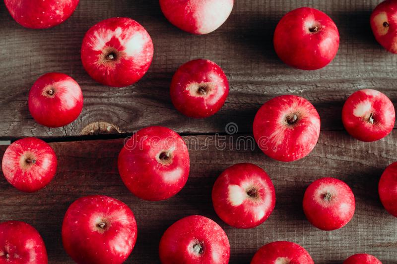 Red apples harvest pattern on a wooden boards. Top view red apples harvest pattern  on a wooden boards royalty free stock photo