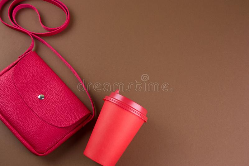 Red bag and take away drink mock up empty cup on brown background copy space. Top view red bag and take away drink mock up empty cup on brown background copy royalty free stock photography