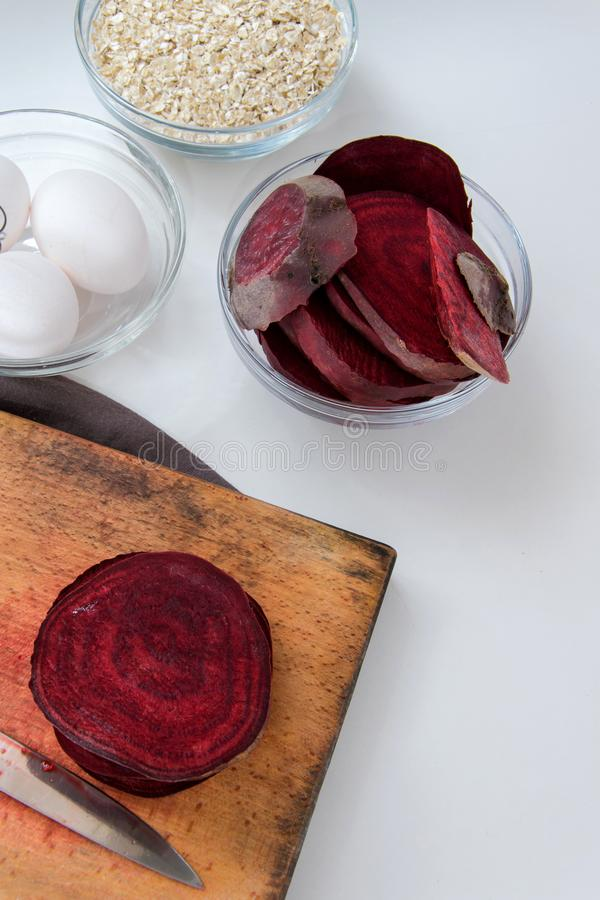 Top view of red beet roots, oats and fresh eggs for healthy dessert cooking. Healthy food background stock photography