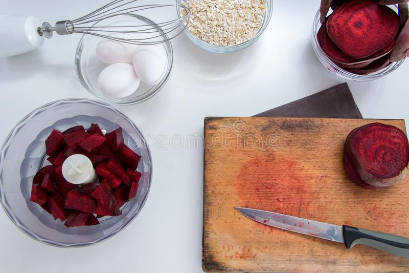 Top view of red beet roots, oats and fresh eggs for healthy dessert cooking. Healthy food background stock image