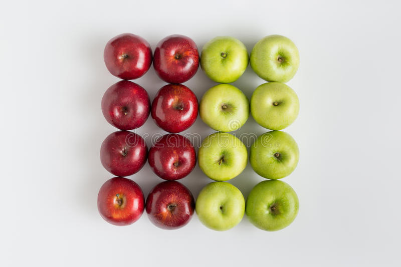 Top view of red and green apples in a row isolated stock images