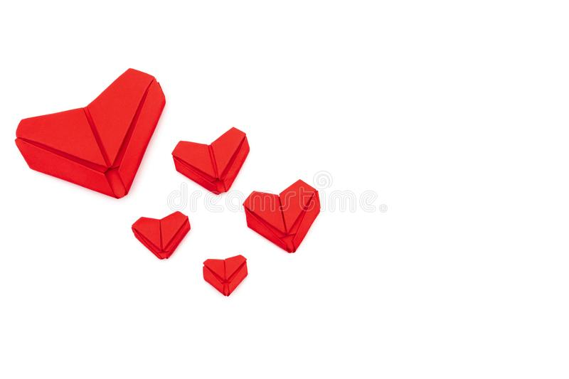 Top view Red heart folded with paper origami hearts showing love for Valentine`s Day Isolated on White Background There is space stock photo