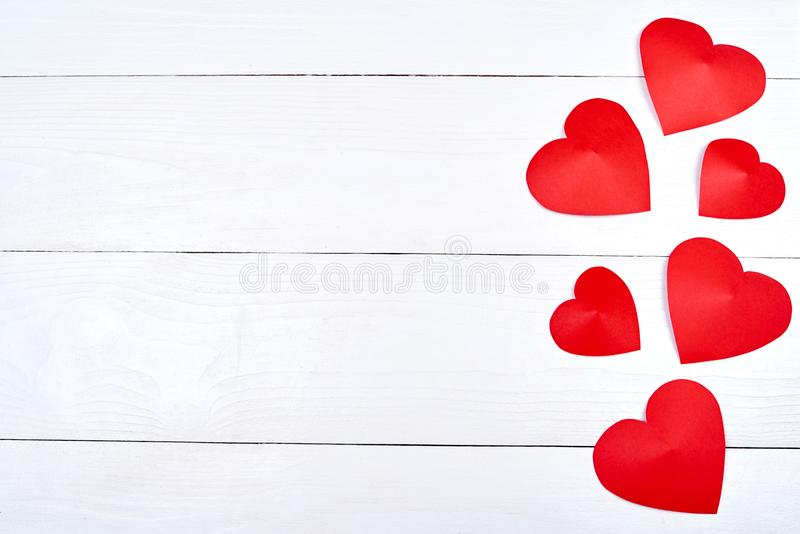 Top view of red paper hearts border on white wooden background, copy space for text. Greeting card mockup for Saint Valentines Day stock photos