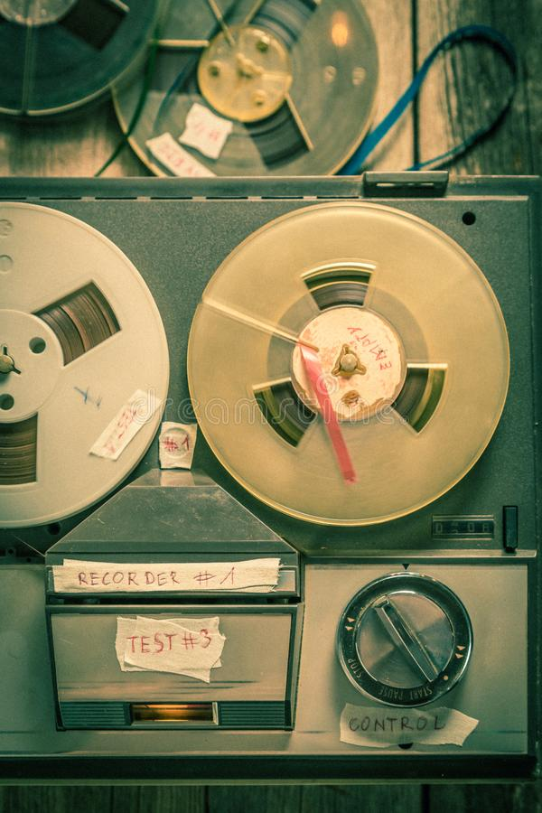 Reel-to-reel tape recorder and rolls tapes. Top view of reel-to-reel tape recorder and rolls tapes stock images
