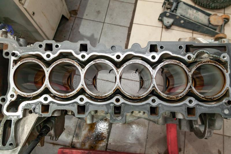 Top view at replacement six cylinder engine used on a crane mounted for installation on a car after a breakdown and repair in a royalty free stock photos
