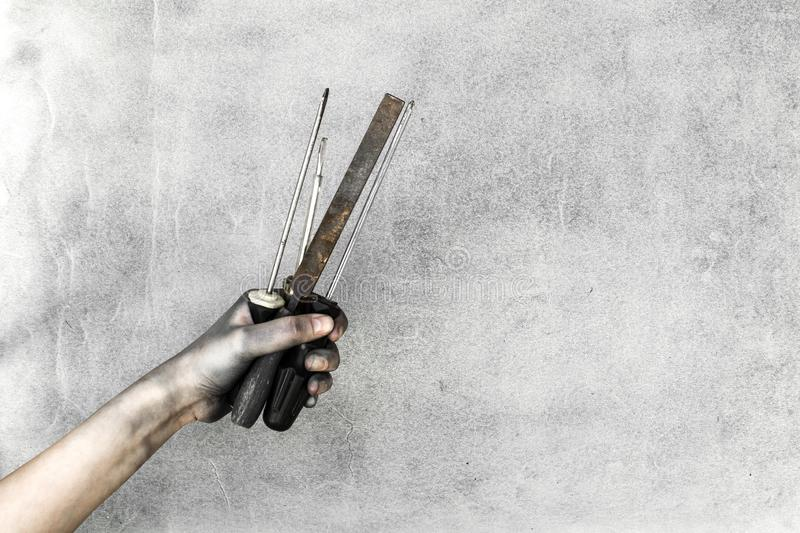 Top view retro working tools with hands on gray background stock image