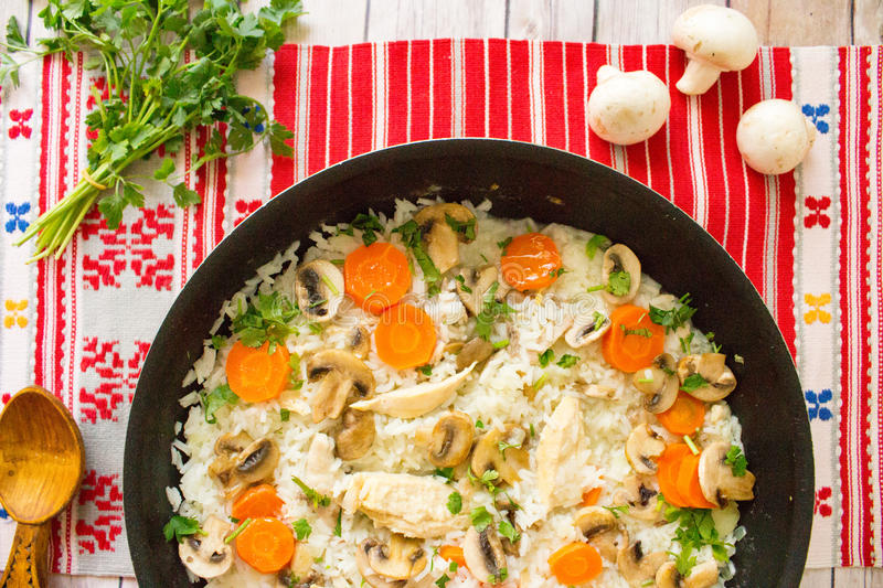 Top view of rice with chicken and vegetables in skillet stock images
