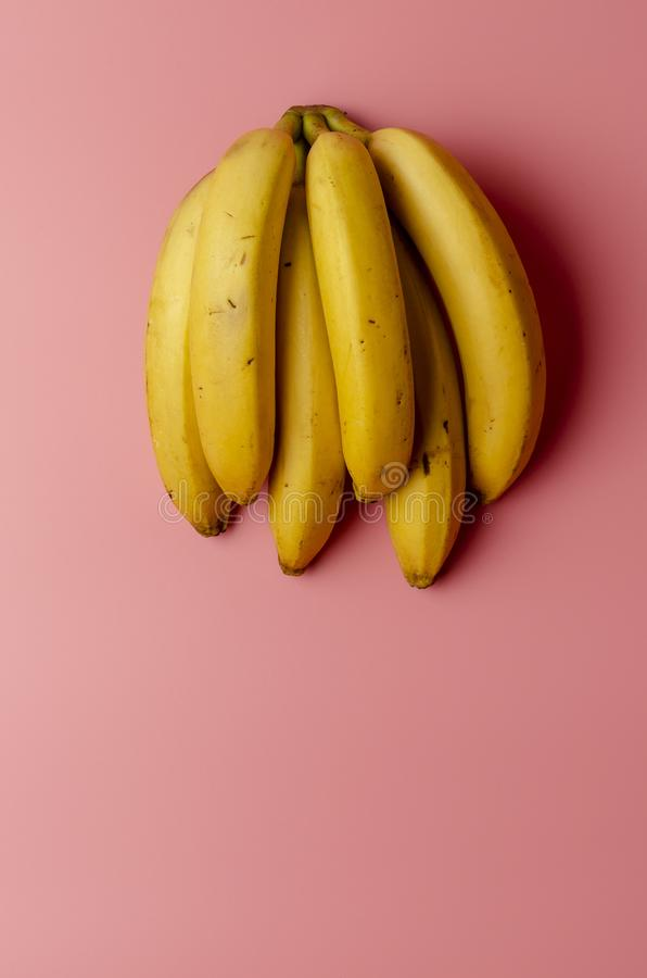 Top view of ripe bananas on a bright pink background. Top view of ripe bananas on a bright pink back stock photos