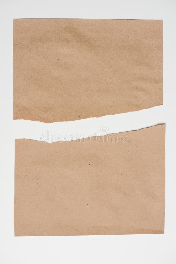 Top view of ripped paper sheet. Isolated on white stock photo