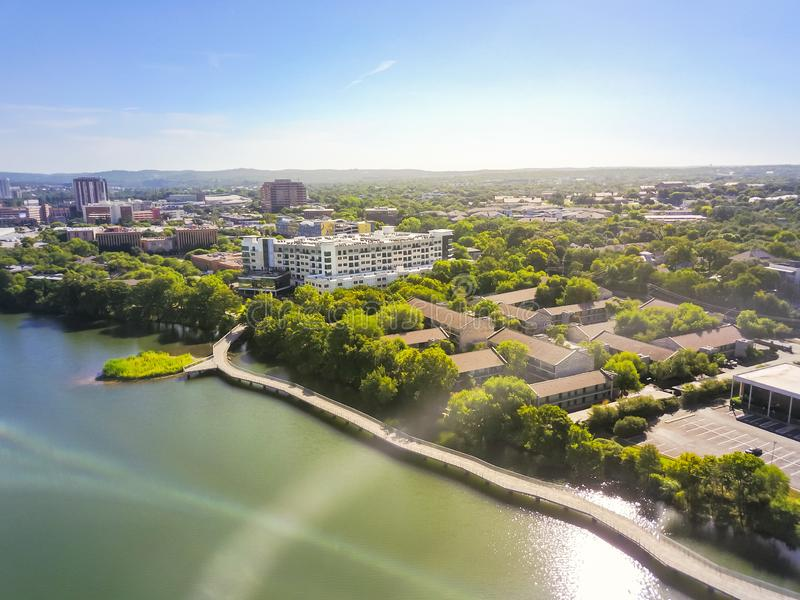 Top view riverside downtown Austin with green beautiful Colorado. Aerial view green downtown Austin, Texas, USA along Lady Bird Lake and Colorado River in sunny royalty free stock photo