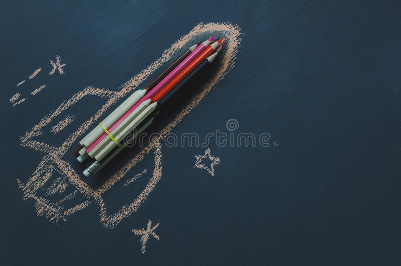 Top view rocket fling on the space with star. stock photos