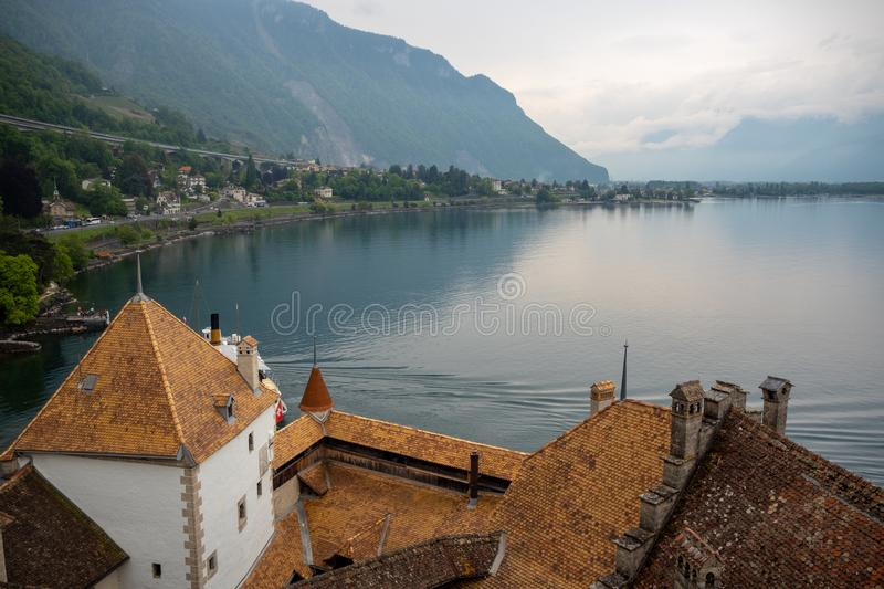 Top view of roof of chateau de chillon the medieval castle in Montreux, Switzerland, on mountain, lake and cloudy sky background. With copy space royalty free stock image