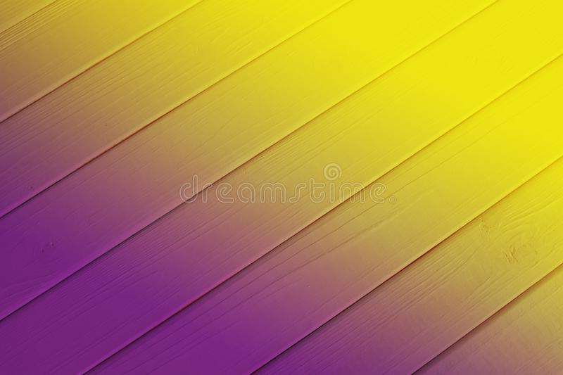 Top view on row of bright pink-yellow wooden planks. Top view on row of bright wooden planks, yellow-pink gradient. Background with natural wooden pattern stock photos
