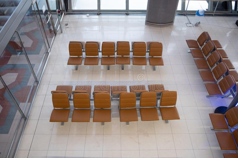 Top view of row of brown seats for waiting on airport stock images