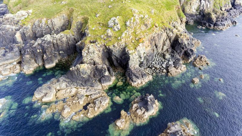 Top view of rugged rocky Cornish shores . stock photos