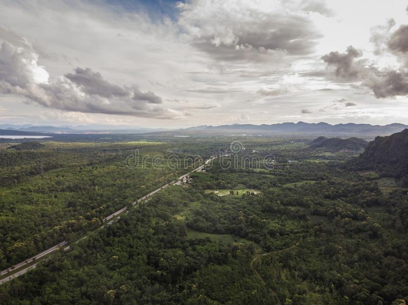 Top View of Rural Road, Path through the green forest and countryside of Thailand, Top view aerial photo from drone stock photography