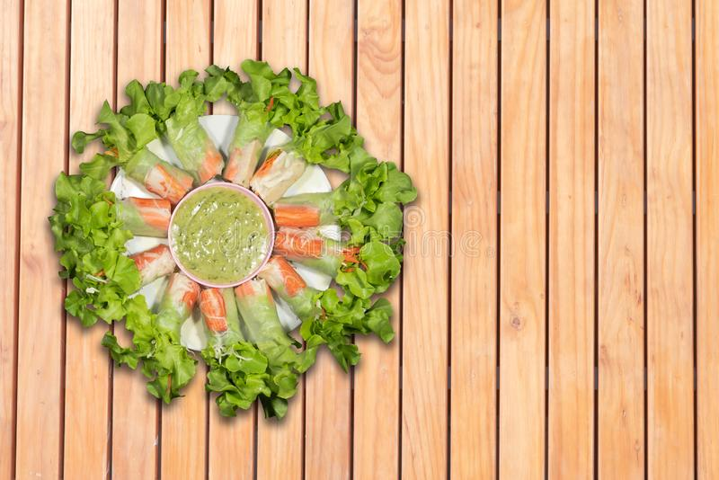 Top view salad rolls in dish on the wooden background royalty free stock images