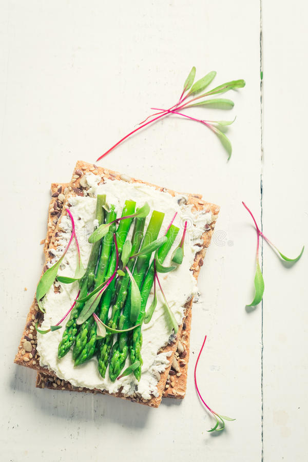 Top view of sandwich with asparagus and fromage cheese. On old white table royalty free stock images