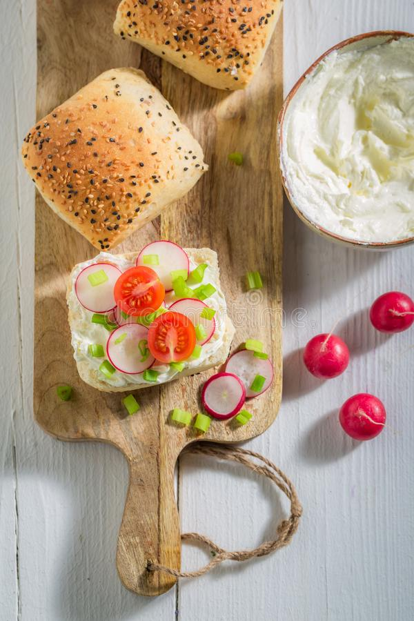 Top view of sandwich with bread, fromage cheese and radish. On wooden table royalty free stock photo