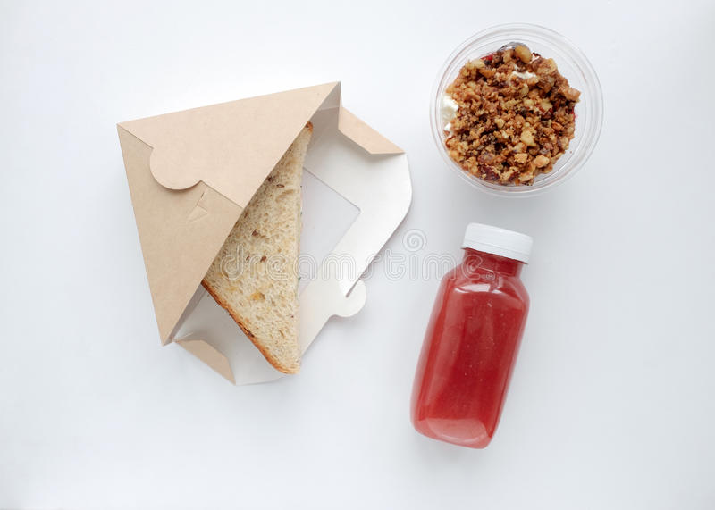 Top view sandwich, dessert and fruit drink on the table royalty free stock photo