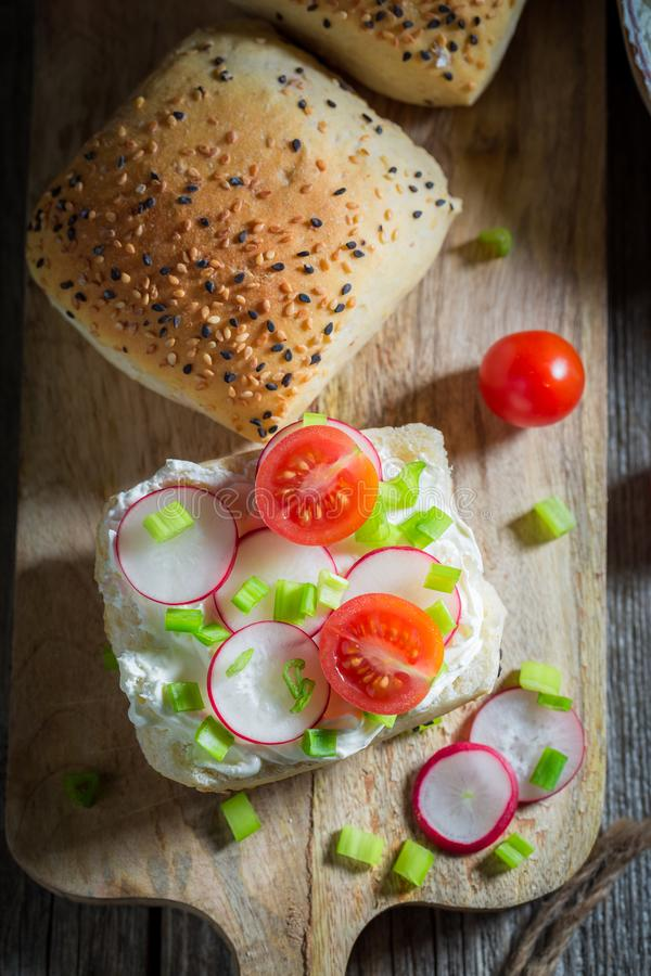 Top view of sandwich with fromage cheese and cherry tomatoes. On wooden table royalty free stock images