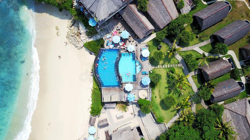 Top view of the sandy beach ocean and pool near the cafe royalty free stock photos