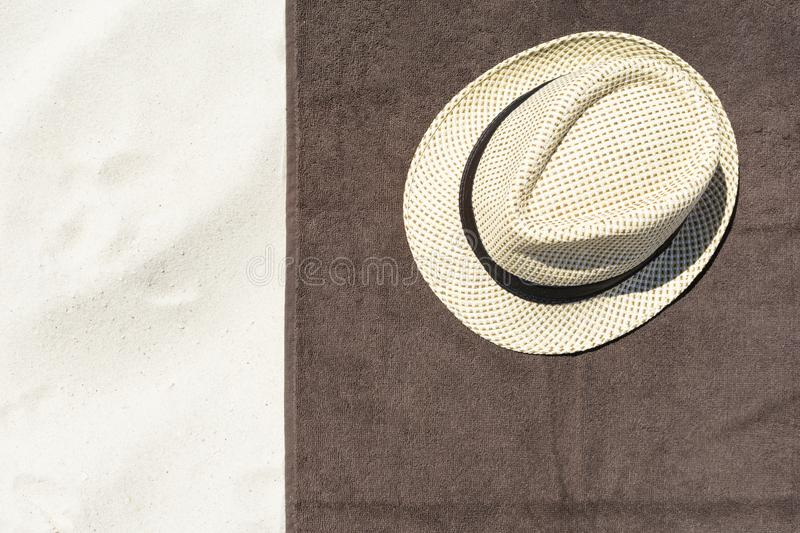 Top view of sandy beach with towel frame and summer accessories. Background with copy space, towel and hat royalty free stock images