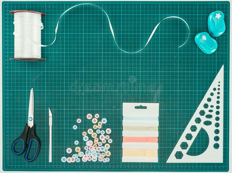 Top view of scissors, buttons and ribbon for scrapbooking decoration royalty free stock photography