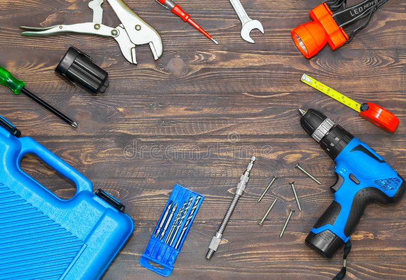 Top view of screwdriver, cordless, electric drill carpenter set. Top view of screwdriver, cordless, electric drill,plier carpenter set with tool on a wooden stock photo
