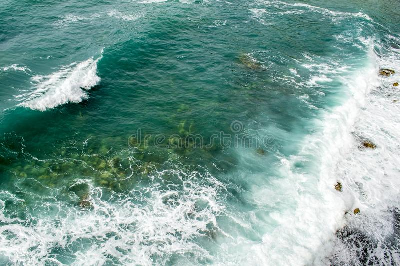 Top view on sea waves. Large waves run to shore stock images