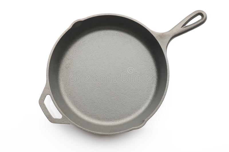 Top View of Seasoned Cast Iron Skillet on White Background royalty free stock photo