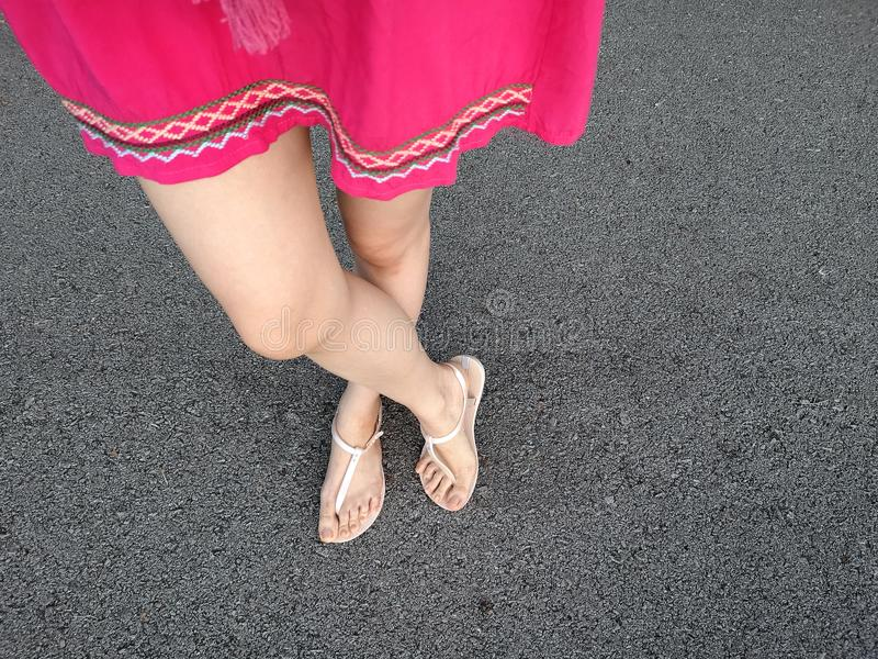 Top View Selfie of Nude Sandals on Gray Concrete. Copy Space, Beautiful Woman Wearing Pink Skirt or Dress and Shoes and Shoes Hips stock photos