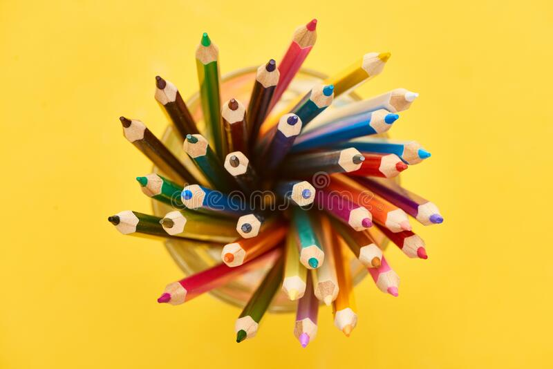 Top view of sharpened and bright color pencils isolated on yellow. Top view of sharpened and bright color pencils isolated on yellow,stock photo royalty free stock photos