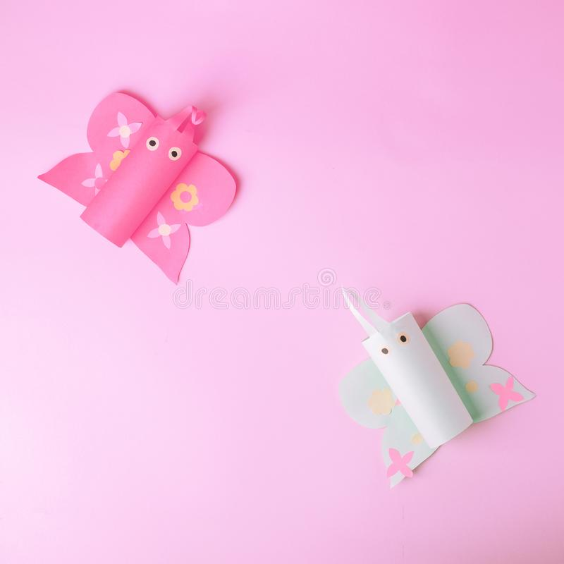 Top view shot of arrangement decoration Happy Easter summer holiday background concept. Flat lay colorful paper craft butterfly on. Pink background. Copy space royalty free stock image