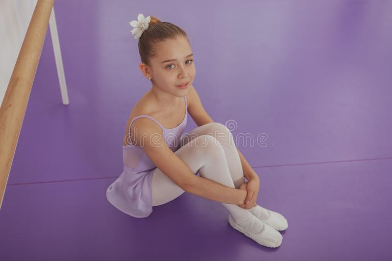 Gorgeous young girl ballerina practicing at dance studio stock images