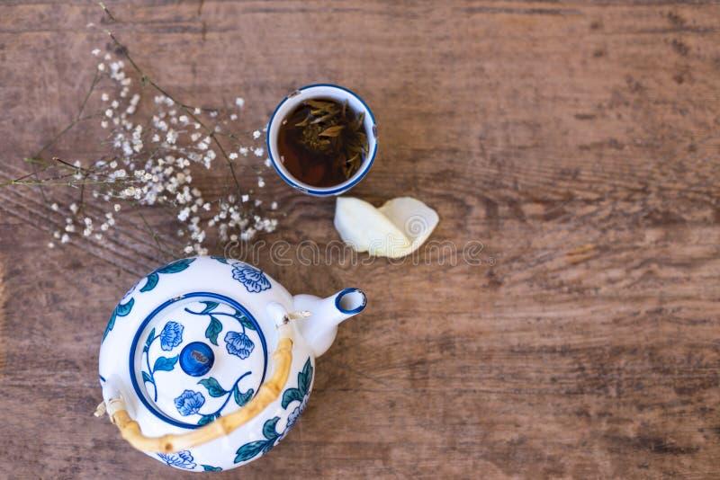 Tea pot and a cup of herbal tea. stock photography