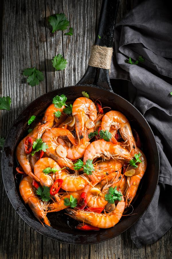 Top view of shrimps on pan with garlic and peppers royalty free stock photography