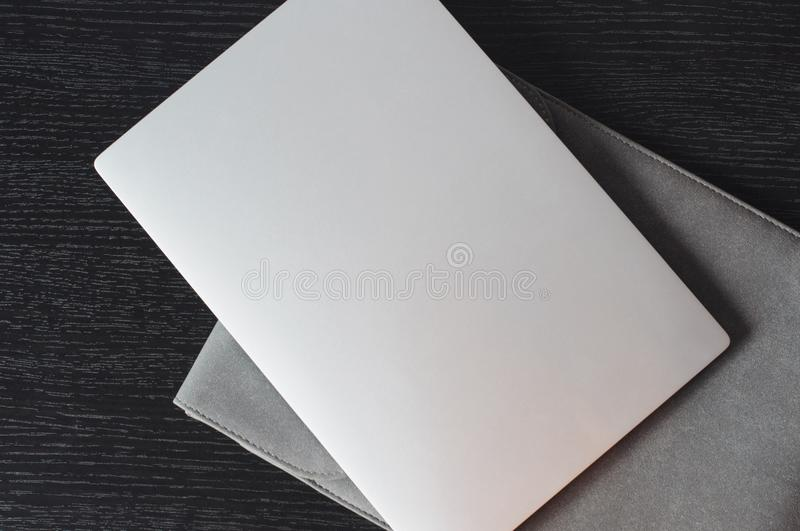 Top view on the silver laptop with grey case stock photo
